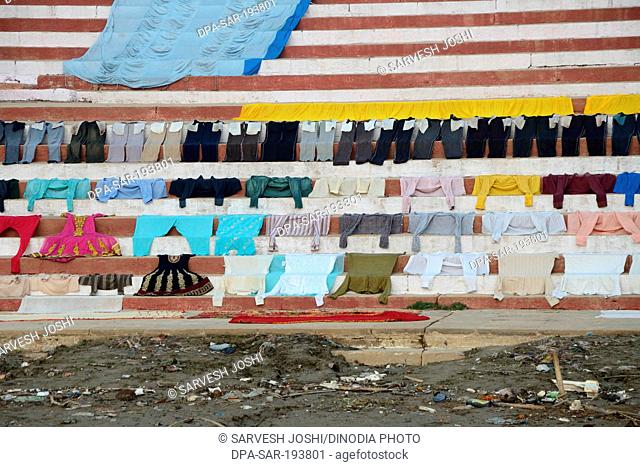 Clothes drying on steps ganga river, varanasi ghat, uttar pradesh, india, asia