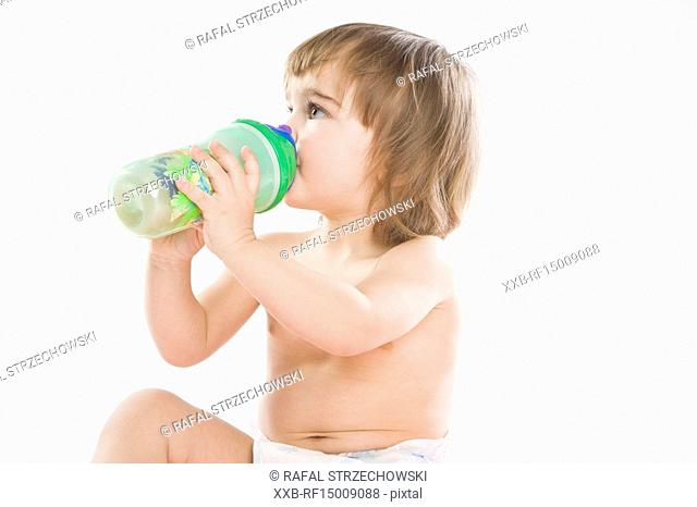 baby drinking form bottle