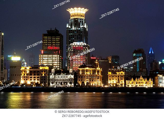The bund on the night and the Huangpu river. The Bund promenade, Shanghai, China. China Shanghai Tourist Shanghai Skyline viewed over the Huangpu river from the...