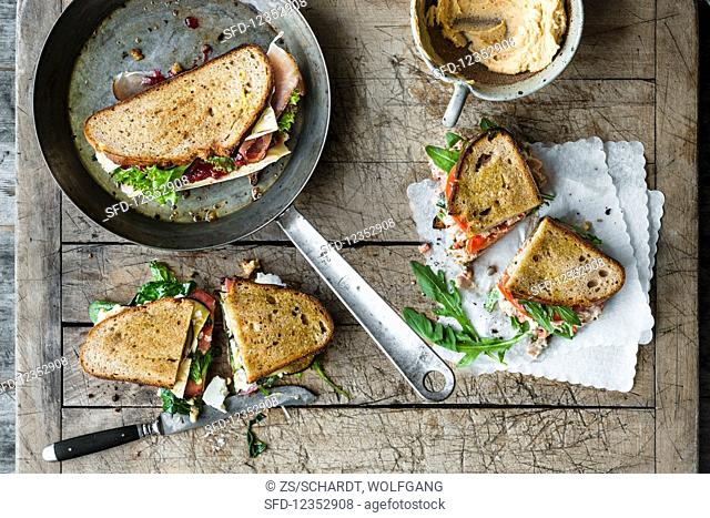 Grilled sandwiches: cranberry, ham, and soft cheese, vitello tonnato with tuna and rocket, and aubergine, houmous, and feta