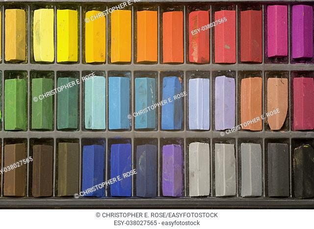 Multi coloured artists pastel crayons pattern close up