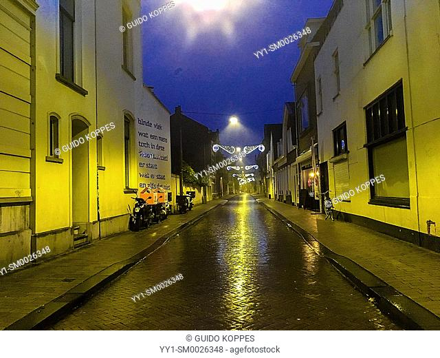 Tilburg, Netherlands. View on Down Town Tuinstraat during a rainy, fall season evening, when no so much people are out in the streets
