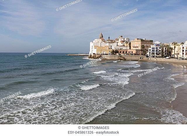 Panorama of the historical center of Sitges from the east with waves