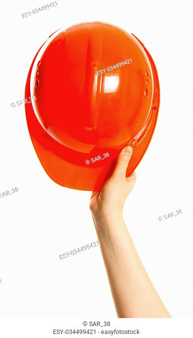 Working tools.Helmet in a hand on a white background