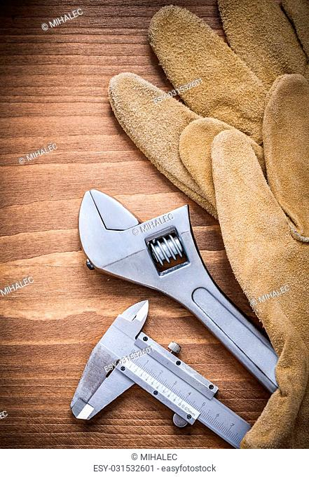 Adjustable wrench leather safety gloves slide caliper construction concept