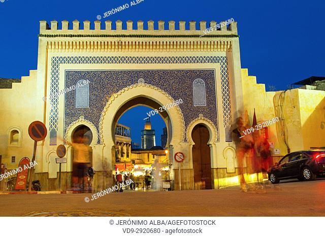 Street life scene. Bab Bou Jeloud gate, main entrance to Souk Medina of Fez, Fes el Bali. Morocco, Maghreb North Africa