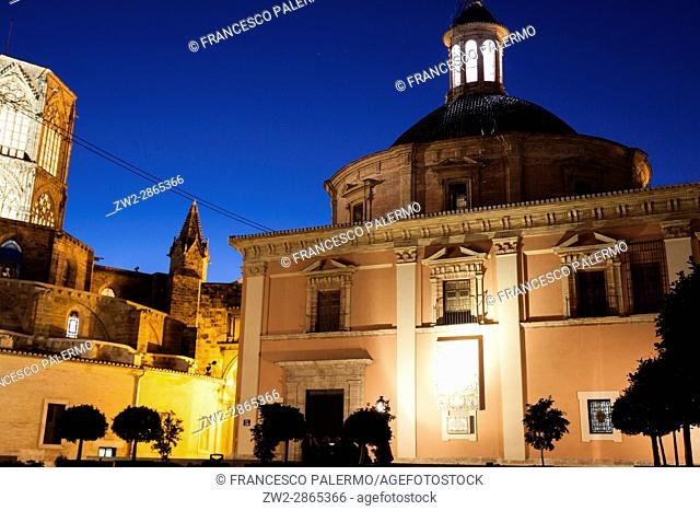 Royal basilica of Our Lady and Miguelete at twilight. Valencia, Spain