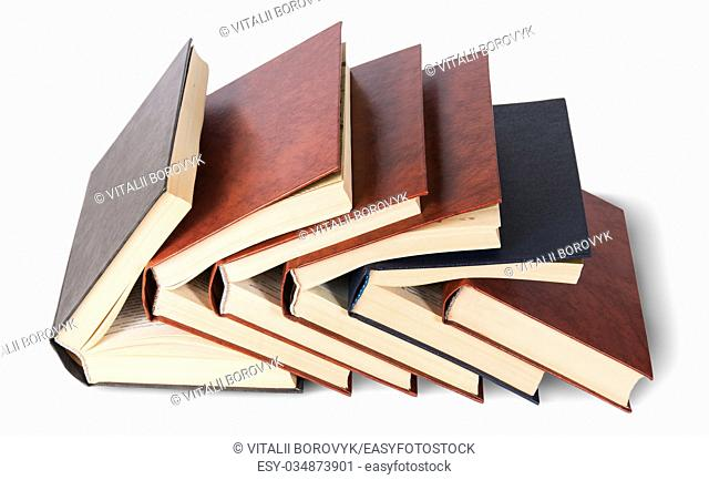 Six old books imbedded in one another top view isolated on white background