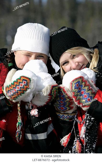 Women holding snowballs