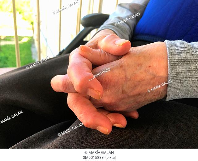 Old woman' s crossed hands
