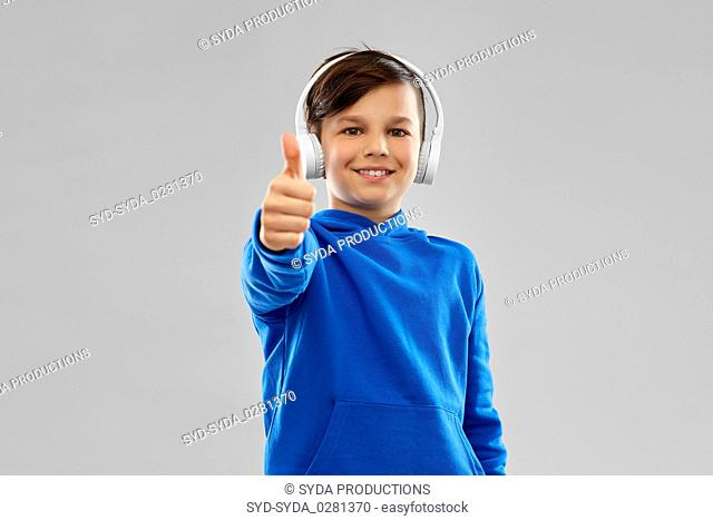 portrait of smiling boy in blue hoodie