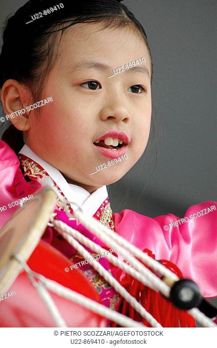 Korean traditional dancer praying the drum