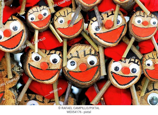 Christmas logs (character relating to a Christmas tradition in Catalonia) for sale at fair. Caga tió. Fira de Santa Llúcia, Barcelona, Catalonia, Spain