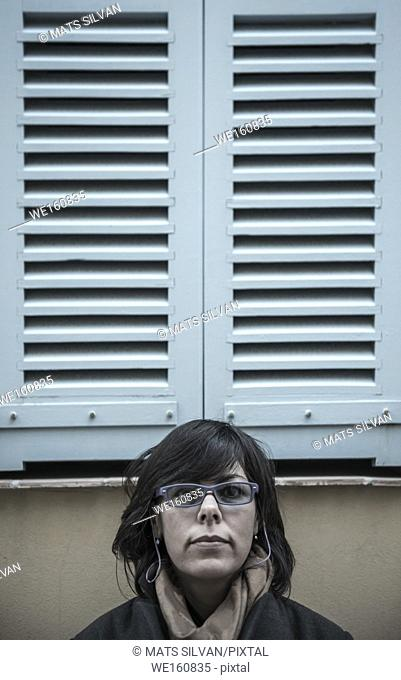 Woman Under a Window with Shutter in Antibes, France