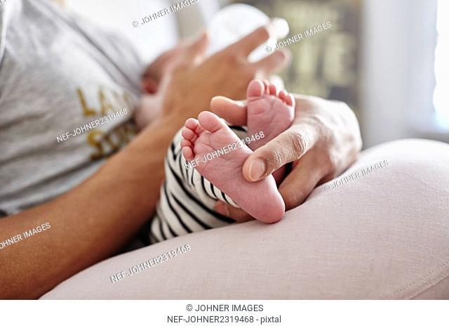 Father feeding baby girl