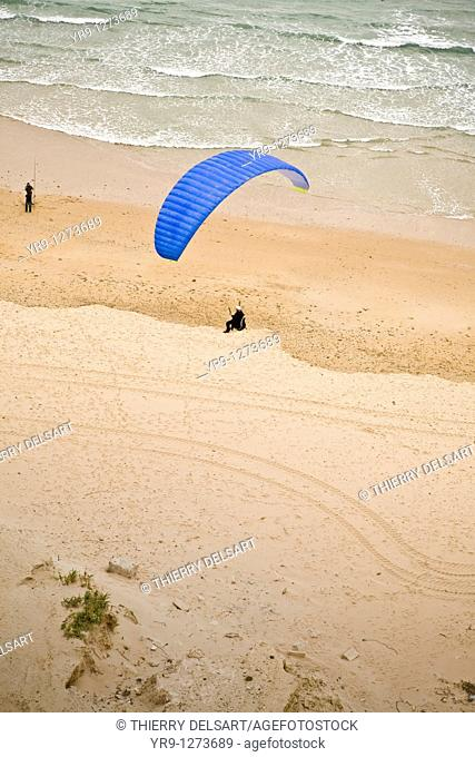 Paraglider landing on Conil de la Frontera's beach  With east wind, one can fly hours right above that spot's dunes