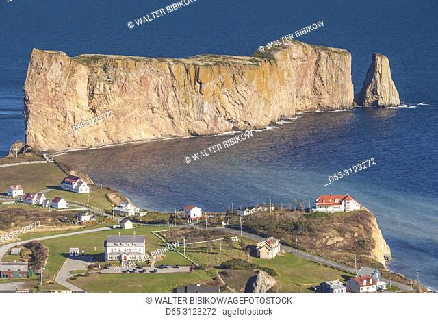 Canada, Quebec, Gaspe Peninsula, Perce, elevated view of town and Perce Rock from Mont Ste-Anne, autumn