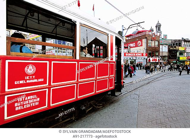 The old tram at Istiklal Caddesi heading to Taksim Square. Istanbul. Turkey