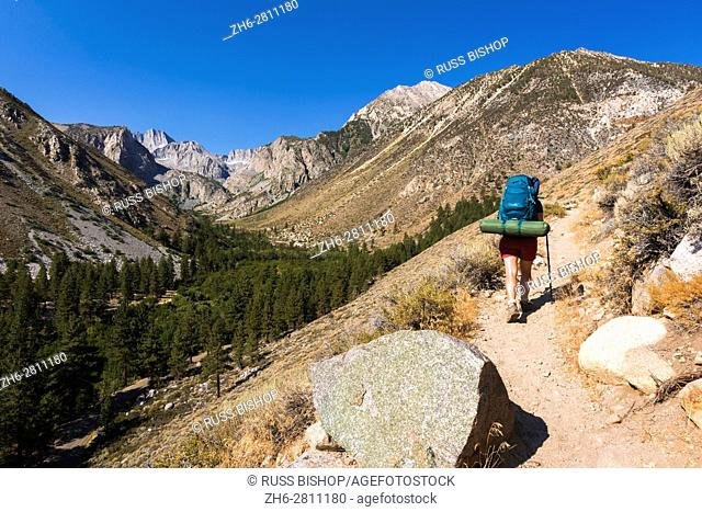 Backpacker on the Big Pine Lakes Trail, Inyo National Forest, Sierra Nevada Mountains, California USA