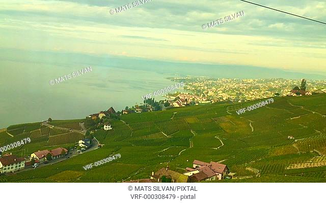 Panoramic View over Lake Geneva and City Lausanne with Mountain in a Sunny Day in Vaud, Switzerland