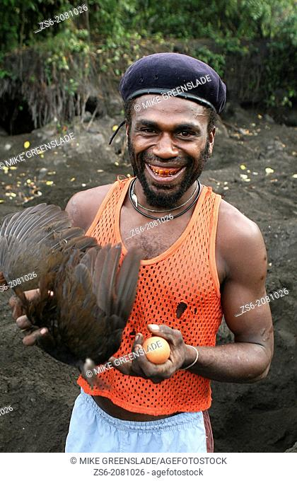 Egg collector with a megapode egg dug from the volcanic ash at the base of Mt Tuvuvur, East New Britain, Papua New Guinea