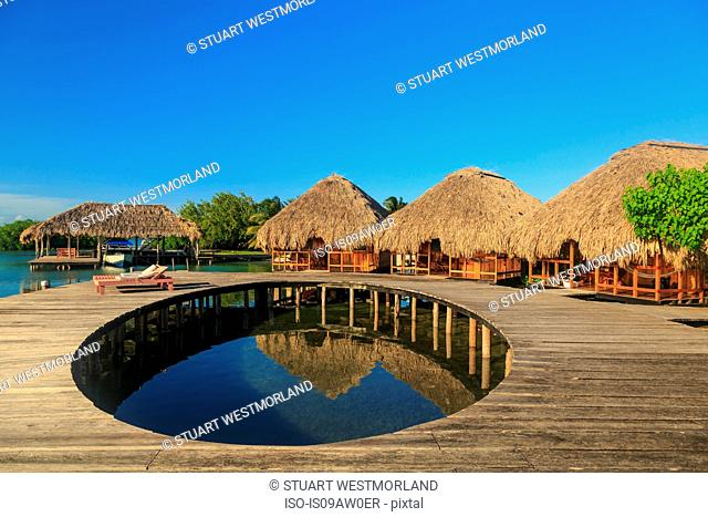 Waterfront boardwalk and chalets, St. Georges Caye, Belize, Central America