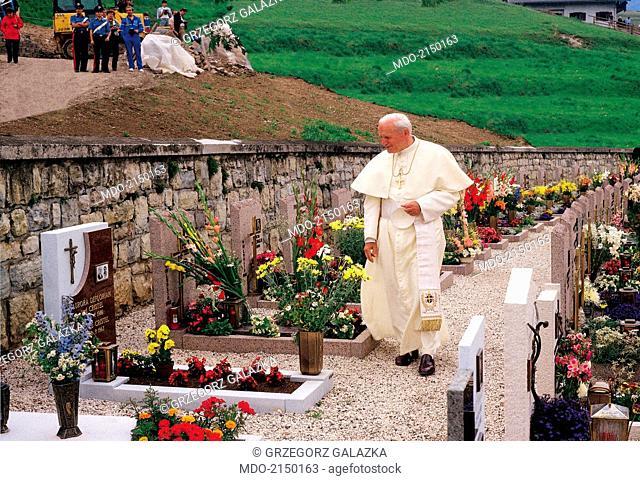 Pope John Paul II (Karol Jozef Wojtyla) visiting a cemetery. 1990s
