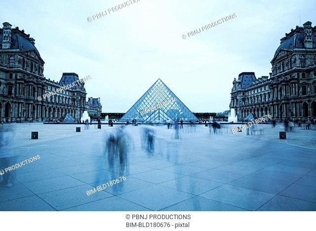 Blurred view of people outside Louvre museum, Paris, Ile-de-France, France