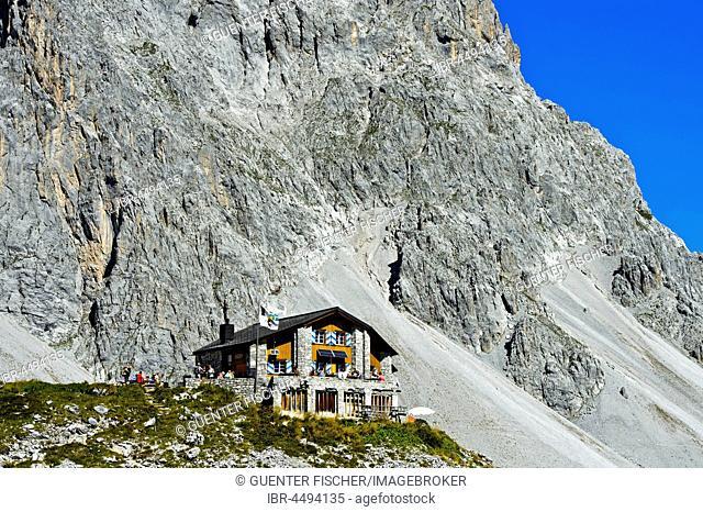 Carschinahütte in front of rock wall of Sulzfluh, Rätikon, St. Antönien, Prättigau, Canton of Grisons, Switzerland