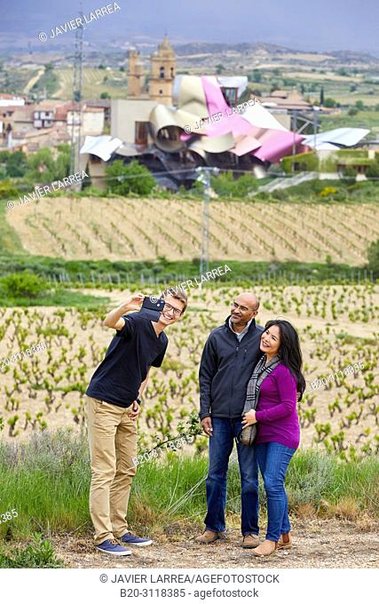 Guide with couple of tourists, Vineyard, Bodegas Marques de Riscal, Elciego, Rioja Alavesa, Araba, Basque Country, Spain, Europe
