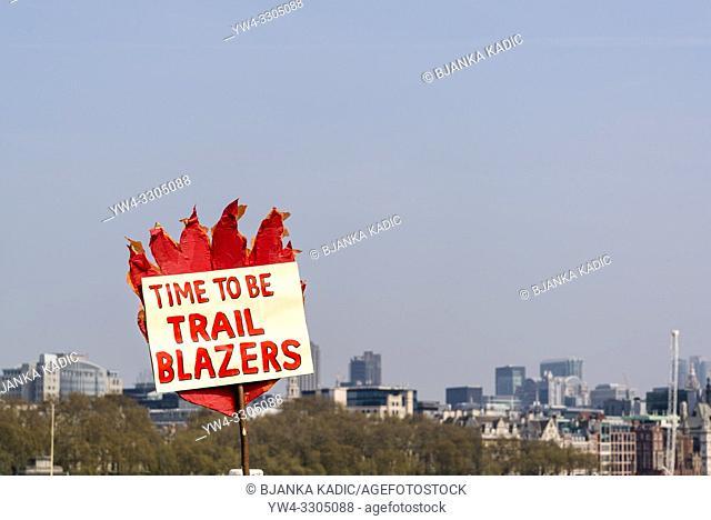 Extinction Rebellion protest on Waterloo Bridge, Time to be Trail Blazers placard, London, UK
