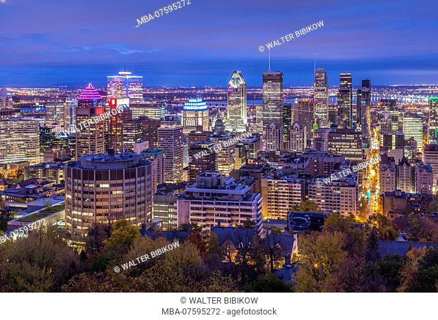Canada, Quebec, Montreal, elevated city skyline from Mount Royal, autumn, dawn