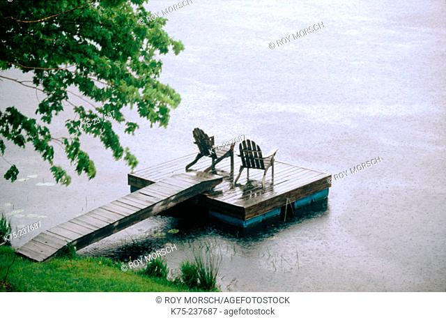 Adirondack chairs in a dock in a rainy summer day. Starlight. Pennsylvania. USA