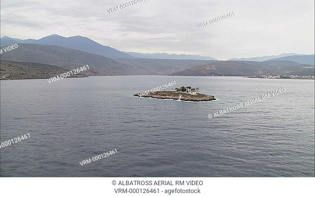Aerial HD video of a small monastery on a tiny island