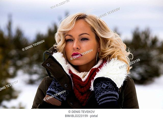 Caucasian woman wearing coat outdoors in winter