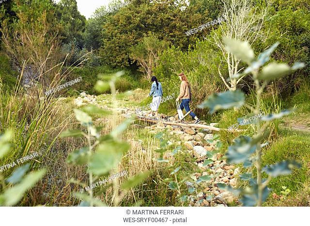 Two young women walking in nature