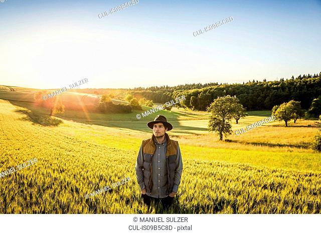 Portrait of mid adult man, standing in field, Neulingen, Baden-W³rttemberg, Germany