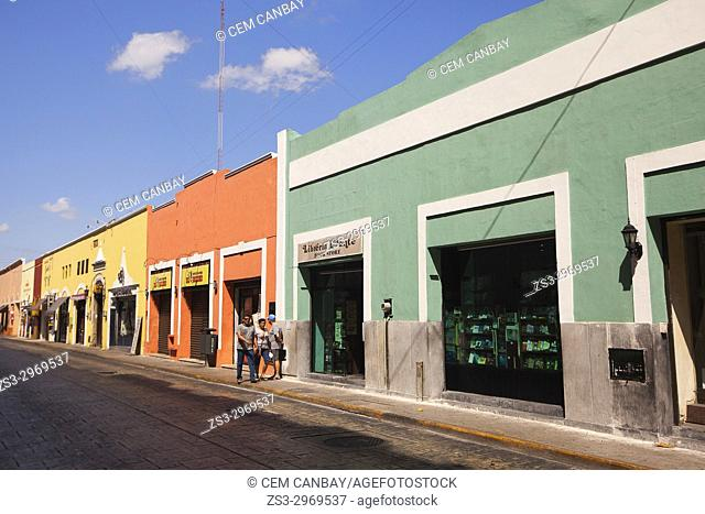 Street scene from the historic city center with a book store in the foreground, Merida, Yucatan State, Mexico, Central America