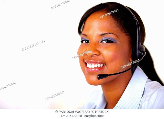 Afro-american secretary smiling at you with headphones - copyspace