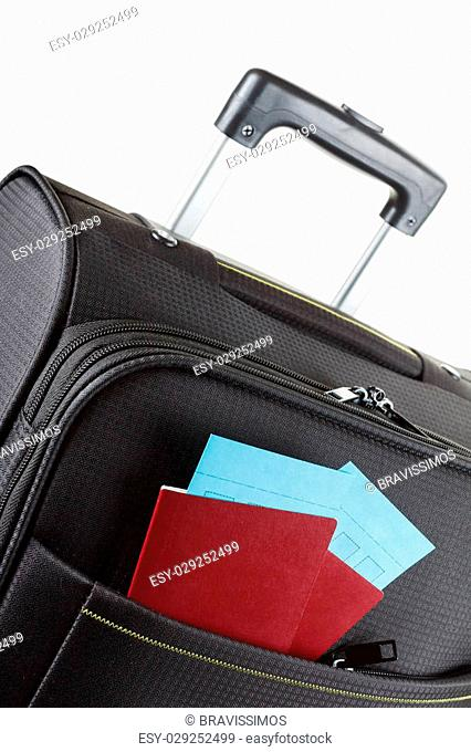 Airline ticket, passport and luggage isolated on white
