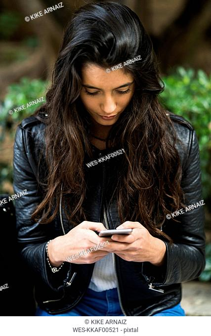 Young woman using a cell phone outdoors