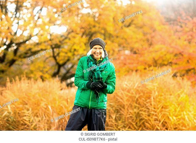 Mature woman exercising in park