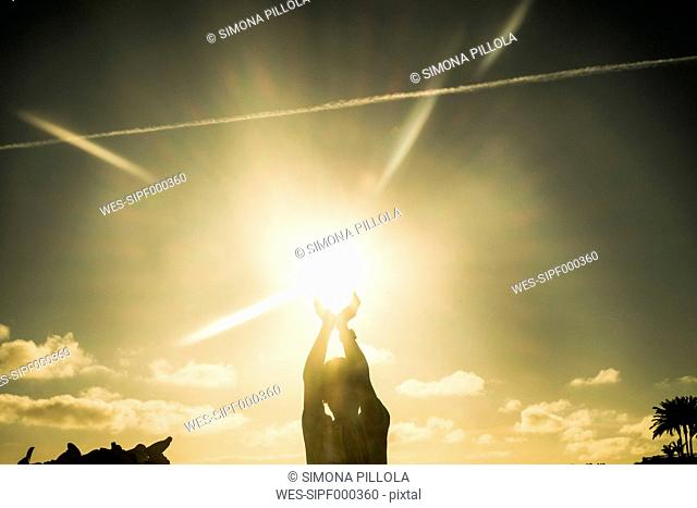 Boy playing with the sun