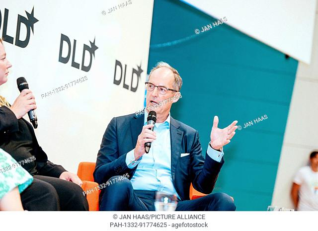 BAYREUTH/GERMANY - JUNE 21: (l-r) Katharina Wagner (Wagner Music Festival) and Gisbert Rühl (Klöckner) speak in a panel discussion on the stage during the DLD...