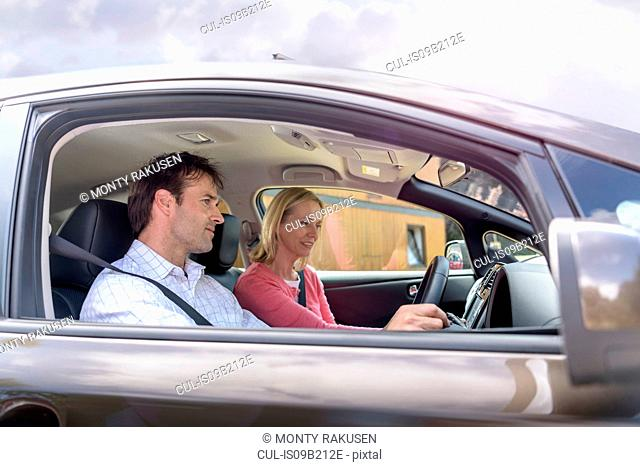 Man and woman in electric car
