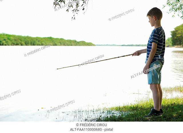 Boy fishing at lake