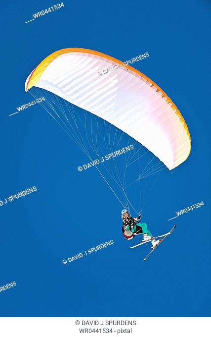 A Paraglider pilot smiles whilst flying