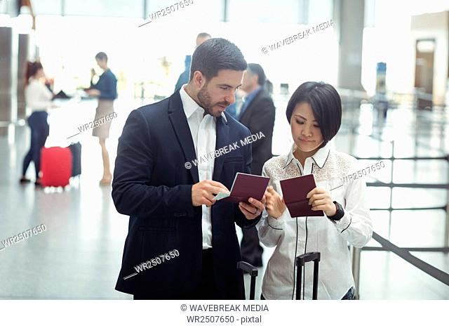 Business man and woman checking their passport