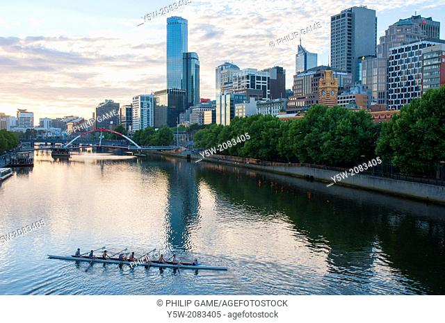 Rowers training on the Yarra River at Princes Bridge, Melbourne, Australia