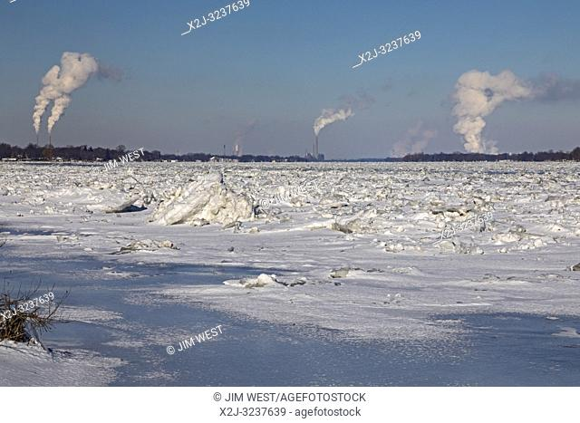 Marine City, Michigan - DTE Energy coal-fired power plants line the U. S. side (left) of the ice-filled St. Clair River. The Canadian side has mostly refineries...